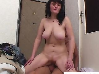Big-chested Brown-haired Granny Fucks On The Floor