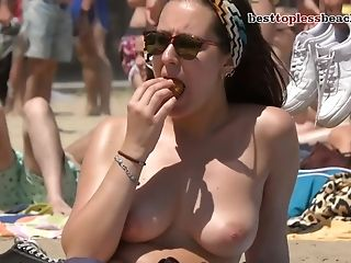 A Nice Woman Goes Stripped To The Waist On The Beach