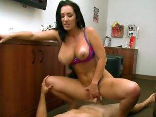 A Very Fit Woman Is Placing Her Mouth Around The Base Of A Dick