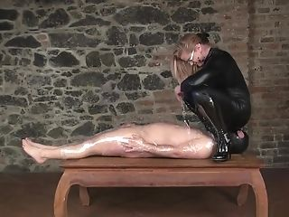 Cougar Mistress In High Boots And Catsuit Uses Cllingfilmed Victim