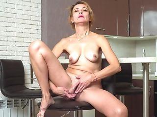 Bossy Russian Woman Oliya Is Masturbating Puss In The Kitchen