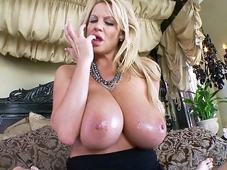 Kelly Madison Milks A Boy's Dick While Taunting With Her Tits