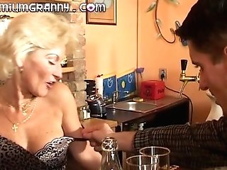 Flawless Granny Looks For An Orgasm At A Bar Table