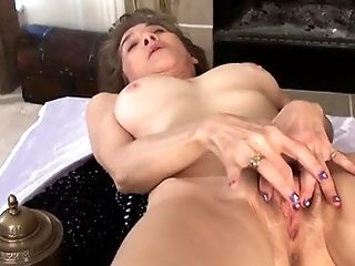 mature caresses her hairy cunt
