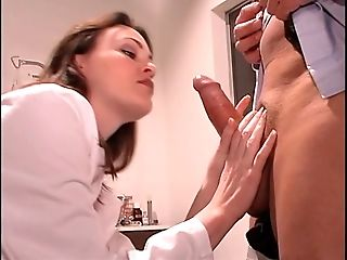 Doctor inserts speculum in rosy-titted nurse's broad-open cunt