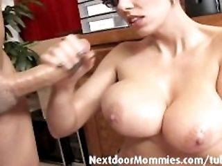 Big jugged mom strokes a black sausage
