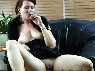 Sophisticated Horny Lady Smokes Her Ciggie While Playing With Her...