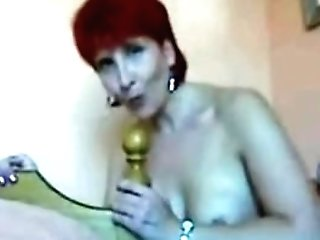 Matures Red-haired Fucks The Bedpost 1