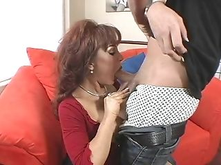 Huge-titted Cougar In A Striking Crimson Top Uses Those Knockers To...