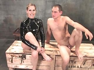 Lady In Black Spandex Displays Cock And Ball Torture Or Pink Cigar...