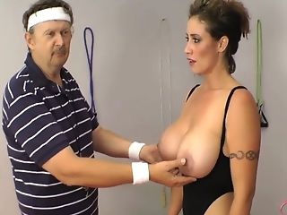 Huge-chested Dark-haired Mom In A Black Gym Suit Seducing Her Older...