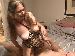 Dark Haired Granny In A Leopard Sundress Gets Her Hairy Cunt...