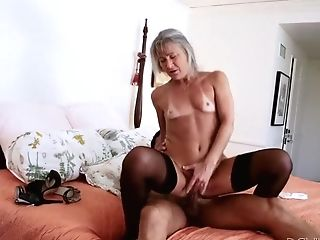 Horny Granny Is Wearing Dark Nylons While Railing Hard Dick Like Crazy