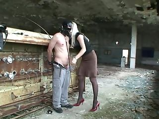 Gimp Gets Manhandled By Lady In Crimson High Stilettos As He Wears...