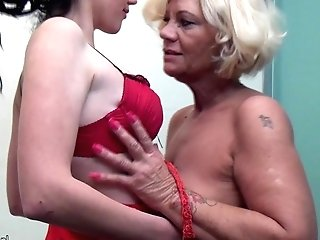 Sexy Granny Pissing On Teenager Lady And Fucks Her