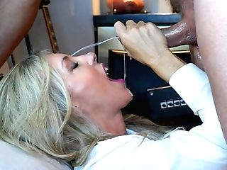 Liberate Lady In A Milky T-shirt, Black Mini-skirt And Gold And...
