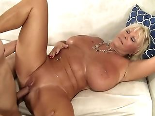 Big Titted Matures Lady Has A Youthfull Stud Drilling Her Sore Cooter