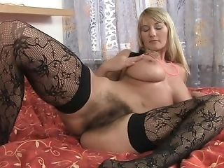 Hairy Beaver Cougar Faux-cock-fucking Herself On A Crimson Couch