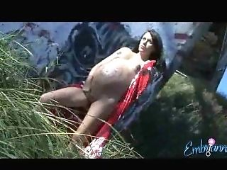 Preggie Lengthy Haired Lady Poses Invitingly For Some Naked...