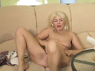 Beautiful And Sexy Granny Sylvie Is Masturbating Her Puckered Twat