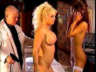 Horny doc in spanking activity with two big tit lovelies