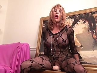 Horny Granny In A Black Lace Catsuit Pounding Her Old Snatch With A...