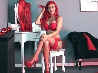 Sexually Charged Crimson Haired Woman Roxi K Tells Erotic Stories...