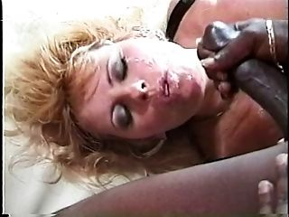 A voluptuous blonde cockslut takes a black dick in her caboose