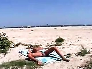 Light-haired Woman Pissing On The Beach
