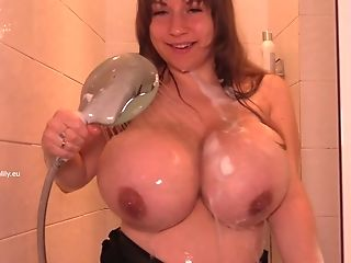 Hot Smiley Matures Soaping Big Tits In The Bathroom