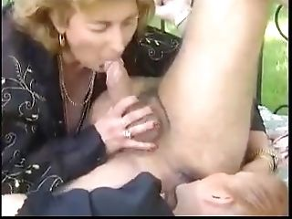 two matures Fuck An man On A Sofa In The Yard