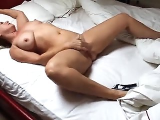 A Cougar In High Stilettos Masturbating