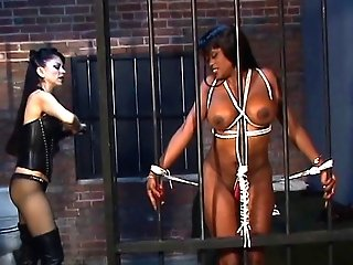 Dark-hued Disco Chick With Phat Tits Is Shackled And Encaged By...